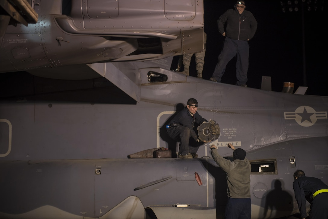 Crew chiefs with the 20th Aircraft Maintenance Unit, 727th Special Operations Aircraft Maintenance Squadron work through the night inspecting and repairing CV-22 Ospreys Oct. 18, 2016 at Cannon Air Force Base, N.M. The 20th Aircraft Maintenance Unit is one of many shops at Cannon that operates 24 hours a day, keeping the 27th Special Operations Wing ready, relevant and resilient any time, any place. (U.S. Air Force Photo by Senior Airman Shelby Kay-Fantozzi/released)