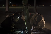 Civilian and active duty crew chiefs with the 20th Aircraft Maintenance Unit, 727th Special Operations Aircraft Maintenance Squadron work together to carefully extract a damaged part from a CV-22 Osprey Oct. 18, 2016 at Cannon Air Force Base, N.M. The 20th Aircraft Maintenance Unit is one of many shops at Cannon that operates 24 hours a day, keeping the 27th Special Operations Wing ready, relevant and resilient any time, any place. (U.S. Air Force Photo by Senior Airman Shelby Kay-Fantozzi/released)