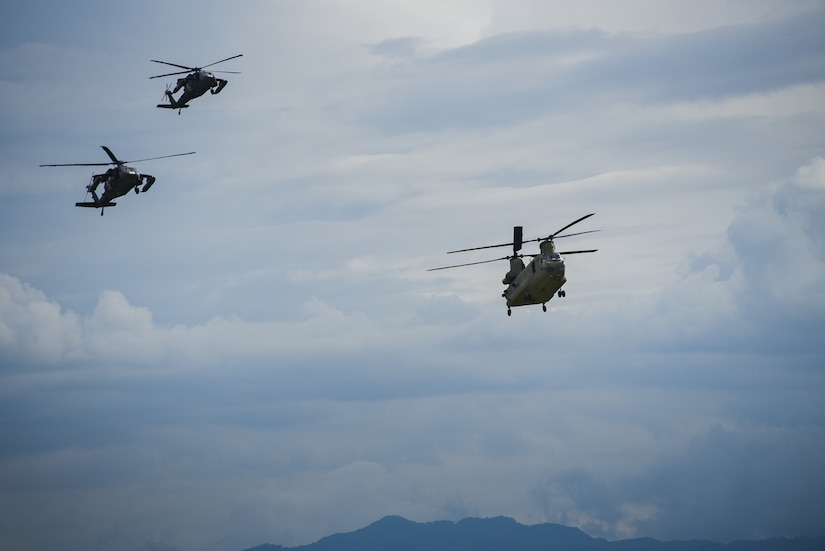Two UH-60 Blackhawk and a CH-47 Chinook helicopters prepare to land at Soto Cano Air Base Oct. 17.  The aircraft are returning from Haiti where Joint Task Force - Bravo was mobilized in support of Joint Task Force – Matthew for hurricane relief after the category four storm devastated the island.
