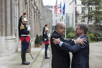 Defense Secretary Ash Carter, right, embraces French Defense Minister Jean-Yves Le Drian in Paris, Oct. 25, 2016, before a meeting. DoD photo by Air Force Tech. Sgt. Brigitte N. Brantley