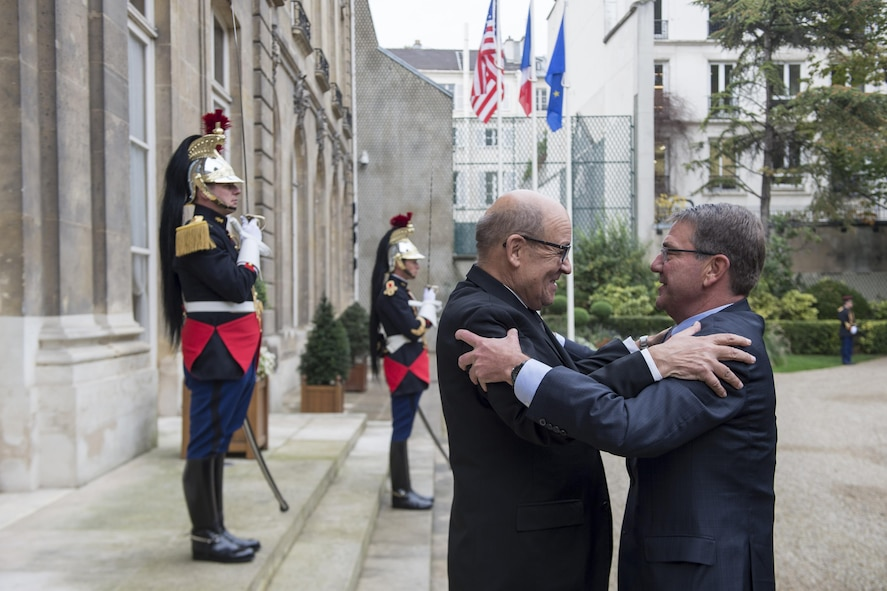 Defense Secretary Ash Carter, right, embraces French Defense Minister Jean-Yves Le Drian in Paris.