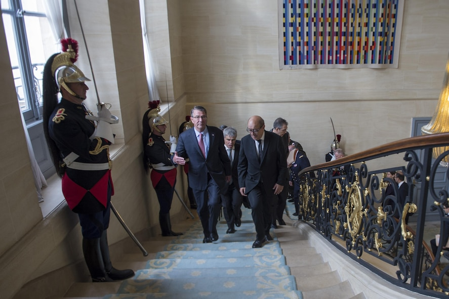 Defense Secretary Ash Carter walks with French Defense Minister Jean-Yves Le Drian.