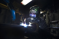 Navy Petty Officer 3rd Class Cullen Kyser welds together a filter housing for a fan coil unit aboard the aircraft carrier USS Dwight D. Eisenhower in the Persian Gulf, Oct. 20, 2016. Kyser is a hull technician. Navy photo by Petty Officer 3rd Class Andrew J. Sneeringer