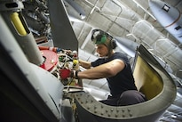 Navy Petty Officer 1st Class Hunter MacLelland inspects the engine of an MH-60S Seahawk helicopter in the hangar bay of the aircraft carrier USS Dwight D. Eisenhower in the Persian Gulf, Oct. 20, 2016. MacLelland is an aviation machinist's mate. The helicopter is assigned to Helicopter Sea Combat Squadron 7. Navy photo by Petty Officer 3rd Class Andrew J. Sneeringer