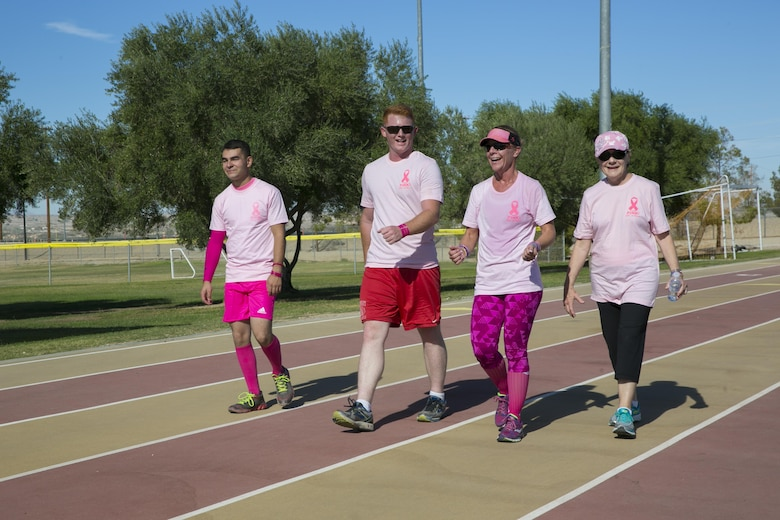 Marine Corps Air Ground Combat Center patrons participate in the Officer Spouse's Club's third annual Pink Breast Cancer Awareness Walk do laps around the track at Felix Field aboard the Marine Corps Air Ground Combat Center, Twentynine Palms, Calif., Oct. 14, 2016. OSC hosted the walk to raise awareness and money for breast cancer research. (Official Marine Corps photo by Lance Cpl. Dave Flores/Released)