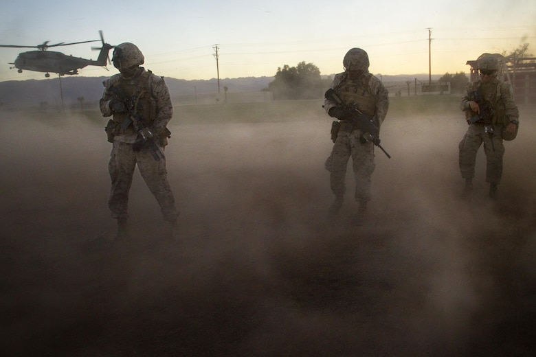 Marines with 2nd Battalion, 3rd Marine Regiment, exit a landing zone during a Non-combatant Evacuation Operation exercise aboard Marine Corps Air Ground Combat Center, Twentynine Palms, Calif., Oct. 14, 2016. (Official Marine Corps photo by Cpl. Connor Hancock/Released)