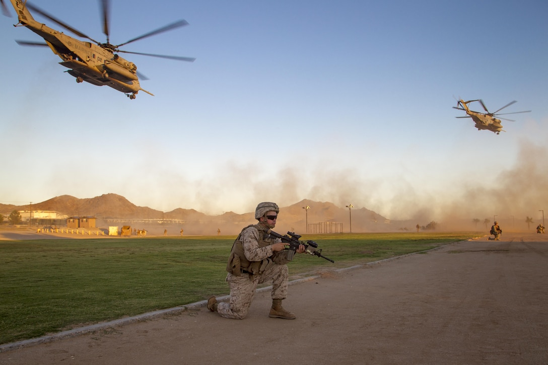 Lance Cpl. Dave Rhodes, rifleman, 2nd Battalion, 3rd Marine Regiment, provides security during a Non-combatant Evacuation Operation exercise aboard Marine Corps Air Ground Combat Center, Twentynine Palms, Calif., Oct. 14, 2016. (Official Marine Corps photo by Cpl. Connor Hancock/Released)