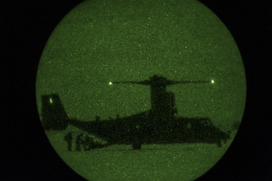 Special Tactics Airmen assigned to the 26th Special Tactics Squadron load onto a CV-22 Osprey during a personnel recovery mission as part of a Full Mission Profile exercise at White Sands Missile Range, N.M., Oct. 12, 2016.  The FMP was utilized to integrate special operations forces and foster tactical maturity through deliberate planning and execution of a force projection package and enable Special Tactics Airmen pre-deployment evaluation. (U.S. Air Force photo by Tech. Sgt. Manuel J. Martinez)