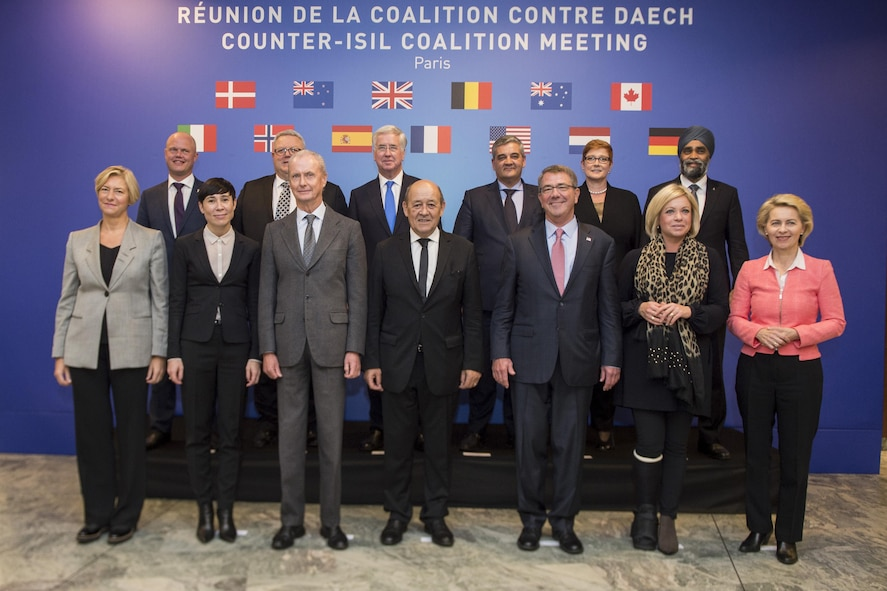 Defense Secretary Ash Carter poses for a picture with other defense ministers at a counter-ISIL meeting in Paris.