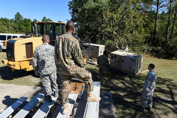 Air Commandos with the 1st Special Operations Civil Engineer Squadron set up generators during the construction of a Joint Special Operations Air Detachment at the Gulfport-Biloxi International Airport in Gulfport, Miss., Oct. 22, 2016. The 1st Special Operations Wing is participating in Exercise Southern Strike to practice tactical skills and test the capabilities of its Airmen and assets in a deployed environment. (U.S. Air Force photo by Senior Airman Jeff Parkinson)