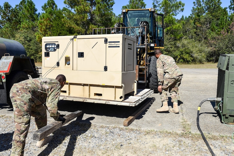 Air Commandos with the 1st Special Operations Civil Engineer Squadron set up generators during the construction of a Joint Special Operations Air Detachment at the Gulfport-Biloxi International Airport in Gulfport, Miss., Oct. 22, 2016. The generators will be used to power the JSOAD during the two-week long Exercise Southern Strike.  (U.S. Air Force photo by Senior Airman Jeff Parkinson)