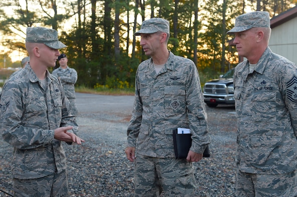 U.S. Air Force Airman 1st Class Alousha Heaney, 633rd Force Support Squadron services journeyman, briefs Maj. Gen. Scott Zobrist, 9th Air Force commander, and Chief Master Sgt. Frank Batten, 9th AF command chief, during a visit at Joint Base Langley-Eusits, Va., Oct. 18, 2016. Heaney showed them a full service single pallet expeditionary kitchen set up for a 633rd Medical Group exercise. (U.S. Air Force photo by Senior Airman Kimberly Nagle)