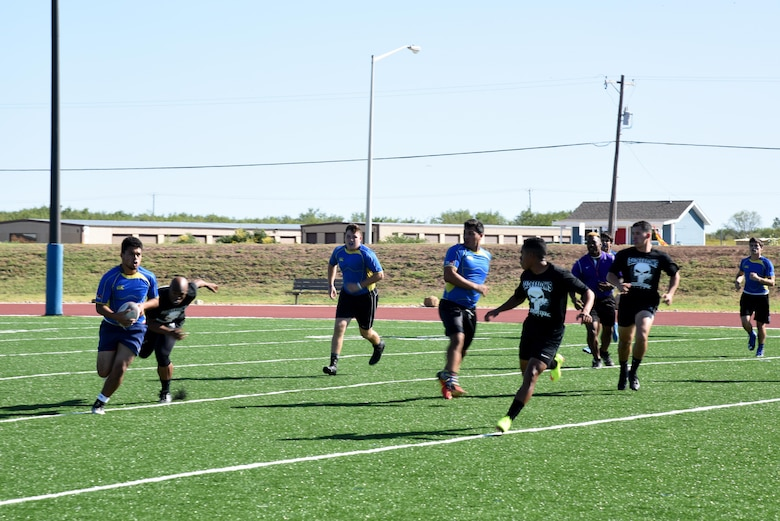The Badfellows, Goodfellow's rugby team, and  Angelo State University Flying Rams' freshman rugby team play a match during the Make Goodfellow Great Trucktoberfest event at the football field on Goodfellow Air Force Base, Texas, Oct. 21, 2016. The Goodfellow Airman who formed the Badfellows is currently a rugby player for the Flying Rams. (U.S. Air Force photo by Senior Airman Joshua Edwards/Released)