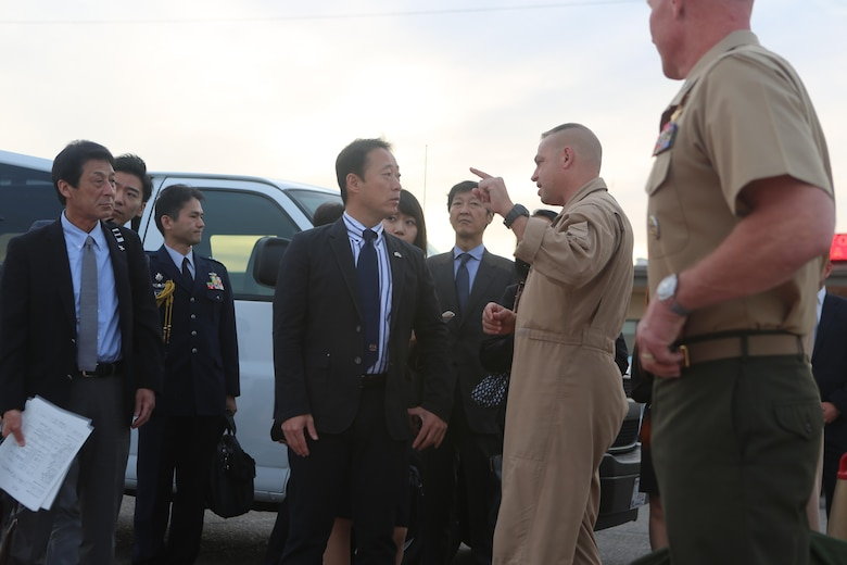 Col. Marcus Annibale, right, commanding officer of Marine Air Group (MAG) 13, welcomes Yoshihiko Fukuda, center, mayor of Iwakuni, Japan, aboard Marine Corps Air Station Yuma, Ariz., Oct. 24. Fukuda visited the air station to speak with Marine Corps aviation officials, observe the capabilities of the F-35B Lightning II and expand his knowledge of the aircraft before Marine Fighter Attack Squadron (VMFA) 121 relocates to MCAS Iwakuni next year. (U.S. Marine Corps photo by Lance Cpl. Harley Robinson/Released)