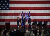 Air Force Chief of Staff Gen. David L. Goldfein passes the Air Force Space Command guidon to Gen. John Raymond Oct. 25, 2016 at Peterson Air Force Base, Colo. Gen. Raymond was previously the Deputy Chief of Staff for Operations, Headquarters Air Force. (U.S. Air Force photo/Tech. Sgt. David Salanitri)