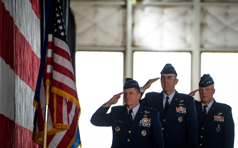Left, Air Chief of Staff Gen. David L. Goldfein, Gen. John Hyten, outgoing commander of Air Force Space Command, and Gen. John Raymond salute during the National Anthem, Oct. 25, 2016 at Peterson Air Force Base, Colo. Raymond took command of AFSPC minutes later. (U.S. Air Force Photo/Tech. Sgt. David Salanitri)