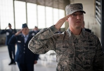 Tech. Sgt. William Marx, 21st Operations Support Squadron, salutes as the Air Force Space Command change of command ceremony begins, Oct. 25, 2016 at Peterson Air Force Base, Colo. Gen. John Raymond,  previously the Deputy Chief of Staff for Operations, Headquarters Air Force, took charge of AFSPC during the ceremony. (U.S. Air Force Photo/Tech. Sgt. David Salanitri)