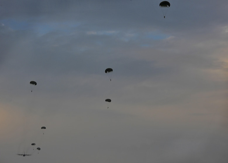U.S. Air Force combat controllers assigned to the 1st Special Operations Squadron and military members from the Republic of Korea (ROK) 255th Special Operations Squadron, perform a static line jump out of a U.S. Air Force MC-130H Combat Talon II, assigned to the 353rd Special Operations Group, at Kunsan Air Base, Republic of Korea, Oct. 22, 2016. Members from the 320th Special Tactics Squadron and 1st SOS worked with the ROK 255th SOS to enhance U.S. and ROK Air Force Special Operations Forces' capabilities. They conducted infiltration methods, jump clearing team operations, airfield establishment, aircraft control and close air support familiarization. (U.S. Air Force photo by Senior Airman Colville McFee/Released)