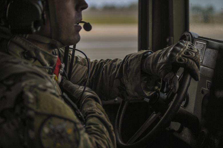 A U.S. Air Force combat controller assigned to the 1st Special Operations Squadron, drives a Humvee while using his radio to communicate at Kunsan Air Base, Republic of Korea, Oct. 22, 2016. Members from the 320th STS and 1st SOS worked with the ROK 255th SOS to enhance U.S. and ROK Air Force Special Operations Forces' capabilities. They conducted infiltration methods, jump clearing team operations, airfield establishment, aircraft control and close air support familiarization. (U.S. Air Force photo by Senior Airman Colville McFee/Released)