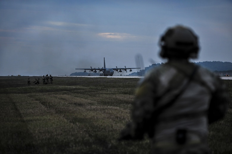 A U.S. Air Force combat controller assigned to the 1st Special Operations Squadron, runs toward a U.S. Air Force MC-130H Combat Talon II, assigned to the 353rd Special Operations Group at Kunsan Air Base, Republic of Korea, Oct. 22, 2016. Members from the 320th STS and 1st SOS worked with the ROK 255th SOS to enhance U.S. and ROK Air Force Special Operations Forces' capabilities. They conducted infiltration methods, jump clearing team operations, airfield establishment, aircraft control and close air support familiarization. (U.S. Air Force photo by Senior Airman Colville McFee/Released)