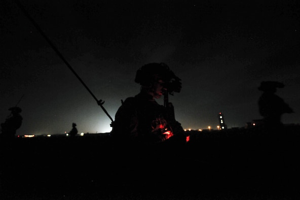 A U.S. Air Force combat controller assigned to the 1st Special Operations Squadron, establishes a line of communication while members from the 320th Special Tactics Squadron and Republic of Korea (ROK) 255th Special Operations Squadron, pull security at Kunsan Air Base, Republic of Korea, Oct. 22, 2016. Members from the 320th STS and 1st SOS worked with the ROK 255th SOS to enhance U.S. and ROK Air Force Special Operations Forces' capabilities. They conducted infiltration methods, jump clearing team operations, airfield establishment, aircraft control and close air support familiarization. (U.S. Air Force photo by Senior Airman Colville McFee/Released)
