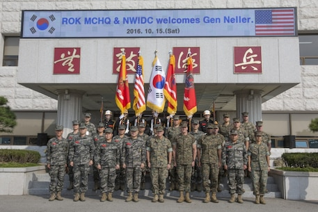 Commandant of the Marine Corps Gen. Robert B. Neller poses for a photo with U.S. Marines and Republic of Korea (ROK) Marines at the ROK Marine Corps Headquarters, Baran, South Korea, Oct. 15, 2016. Neller visited Baran to meet with ROK Marine Corps leadership. (U.S. Marine Corps photo by Cpl. Samantha K. Braun)