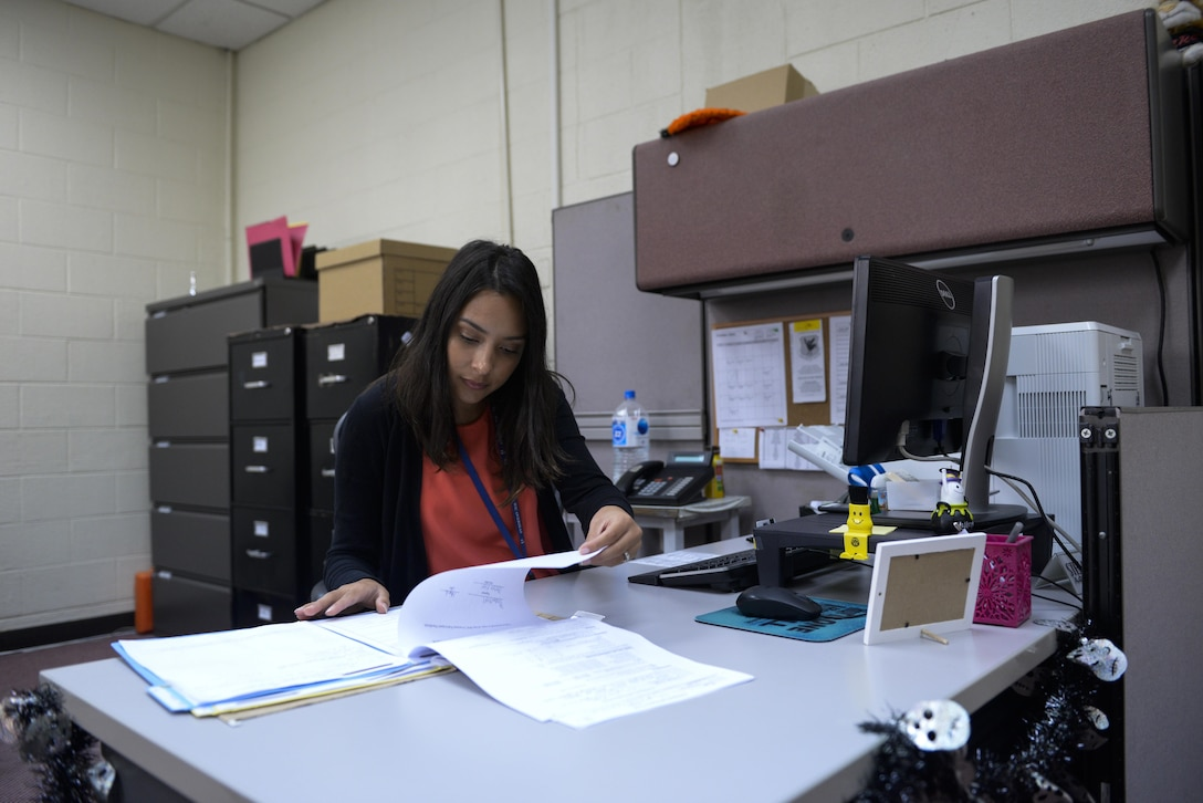 Stefani Carroccia, Kadena Women, Infants and Children's office administrative assistant, checks documents before an appointment at Kadena Air Base, Japan, Oct. 25, 2016. WIC is a supplemental food and nutrition education program, authorized in 1972 by the Child Nutrition Act, helping young Airmen and their families get the best nutrition options for their families. The program provides eligible participants with supplemental nutritious food, nutrition counseling and education, nutrition-health screening, and referrals to other health agencies. (U.S. Air Force photo by Senior Airman Stephen G. Eigel/Released)