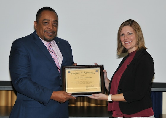 DLA EEO director, Ferdinand LeCompte presents Katrina Labouliere with a certificate of appreciation.