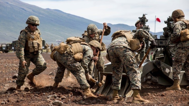 "Marines with Bravo Battery, 1st Battalion, 12th Marine Regiment's ""Black Sheep,"" prepare their M777 Lightweight Towed Howitzer by digging and burying the gun's rear spades during a direct fire training exercise as part of Lava Viper 17.1, a staple in the battalion pre-deployment training on Oct. 16, 2016, at Range 13 aboard Pohakuloa Training Area, Hawaii. Lava Viper Provides the Hawaii-based Marines with an opportunity to conduct various movements, live-fire and tactical, integrating combined arms exercises."