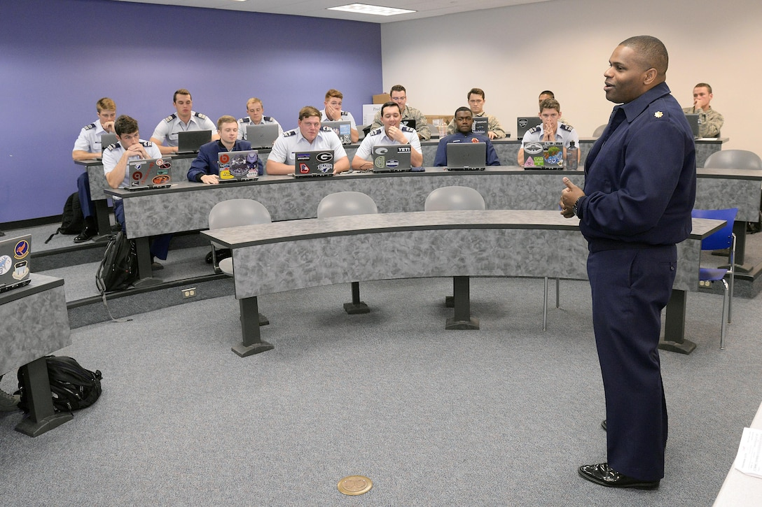 Maj. Paul Prosper, an assistant professor in the U.S. Air Force Academy's Management Department, teaches class Oct. 24, 2016. Prosper keeps a busy schedule balancing his duties as an educator with improving the lives of children and at-risk young adults in Colorado Springs. (U.S. Air Force photo/Mike Kaplan)