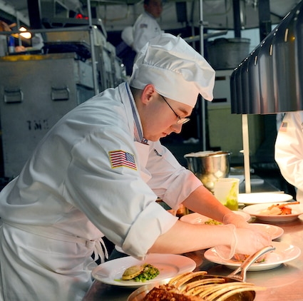 U.S. Marine Sgt. Joseph Hale arranges a dinner plate for the Pentagon team during the 2014 Military Arts Competition at Fort Lee, Va. March 11, 2014. (DoD photo by EJ Hersom)