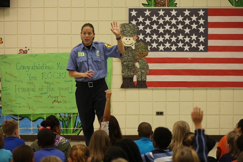 Brandee Ridgway asks students questions about fire safety at W.J. Gurganus Elementary School in Havelock, N.C., Oct. 20, 2016. The Cherry Point Fire and Emergency Services Department visited the school to demonstrate what to do in fire emergencies and how to prevent them. The students also learned about the equipment firefighters use every day to complete their mission. Ridgway is a fire inspector with the Cherry Point Fire and Emergency Services Department. (U.S. Marine Corps photo by Lance Cpl. Mackenzie Gibson/Released)