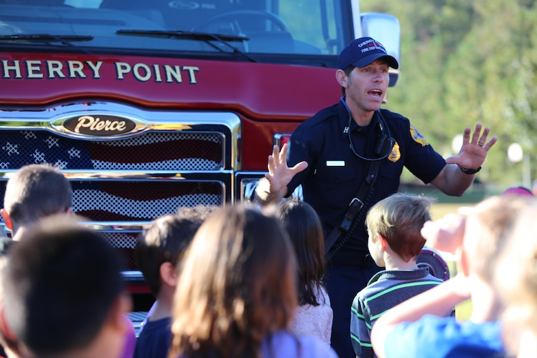 Edward Hudson explains the functions of a ladder truck to students at W.J. Gurganus Elementary School in Havelock, N.C., Oct. 20, 2016. The Cherry Point Fire and Emergency Services Department visited the school to demonstrate what to do in fire emergencies and how to prevent them. The students also learned about the equipment firefighters use every day to complete their mission. Hudson is a fire captain with the Cherry Point Fire and Emergency Services Department. (U.S. Marine Corps photo by Lance Cpl. Mackenzie Gibson/Released)