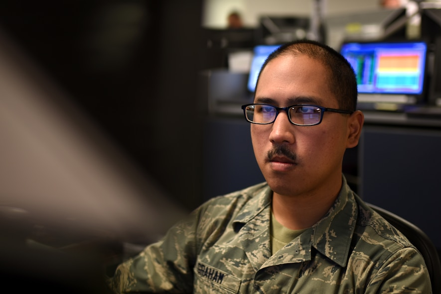 PETERSON AIR FORCE BASE, Colo. – Senior Airman Edward Graham, 561st Network Operations Squadron vulnerabilities remediation operator, works diligently alongside his squadron to scour over 800,000 computers for threats at Peterson Air Force Base, Colo., Oct. 20, 2016. Common threats come from personal external devices such as cell phones and hard drives. Insider threats from disgruntled employees seeking to cause harm are other possible concerns Airmen from the NOS face daily. (U.S. Air Force photo by Airman 1st Class Dennis Hoffman)