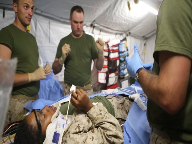 U.S. Navy medical technicians conduct a simulated surgery on a casualty during a  Marine Corps Combat Readiness Evaluation completed by 1st Medical Battalion, 1st Marine Logistics Group at Camp Pendleton, Calif., Oct 17-21, 2016. The MCCRE was designed to push the Sailors and Marines to the limit with scenarios they would be likely to see in a combat environment such as improvised explosive devices, downed aircraft and mass casualty drills. Marines and Sailors were required to work side-by-side to ensure mission success. (U.S. Marine Corps photo by Lance Cpl. Jocelyn Ontiveros)