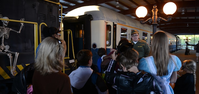 families prepare to walk through a train car at the night at the transportation museum event - Halloween Events In Va