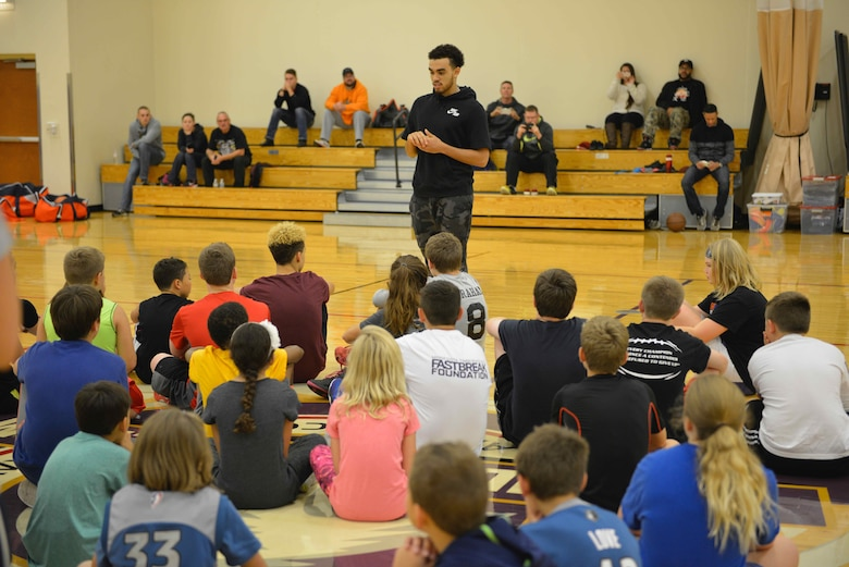Tyus Jones, Minnesota Timberwolves point guard, talks with participants at the military kids basketball clinic Oct. 22.
