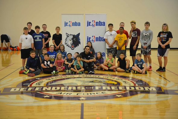 Tyus Jones, Minnesota Timberwolves point guard, poses with participants at the military kids basketball clinic Oct. 22.