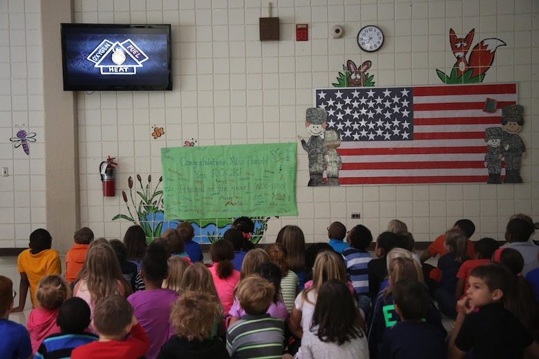 A group of second graders watch an educational fire safety video at W.J. Gurganus Elementary School in Havelock, N.C., Oct. 20, 2016. The Cherry Point Fire and Emergency Services Department visited the school to demonstrate what to do in fire emergencies and how to prevent them. The students also learned about the equipment firefighters use every day to complete their mission. (U.S. Marine Corps photo by Lance Cpl. Mackenzie Gibson/Released)