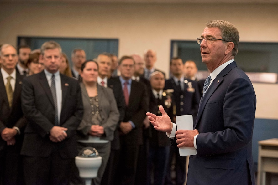Defense Secretary Ash Carter speaks while presenting the Joint Meritorious Unit Award to the U.S. Mission to NATO.