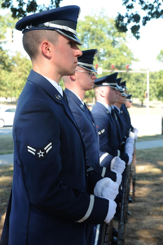U.S. Air Force Honor Guard firing party members await orders during a full-military honors funeral demonstration Oct. 6, 2016 Little Rock Air Force Base, Ark. Team Little Rock Honor Guard members are selected from the base populace for a six month tour on the team. (U.S. Air Force photo by Airman Grace Nichols)