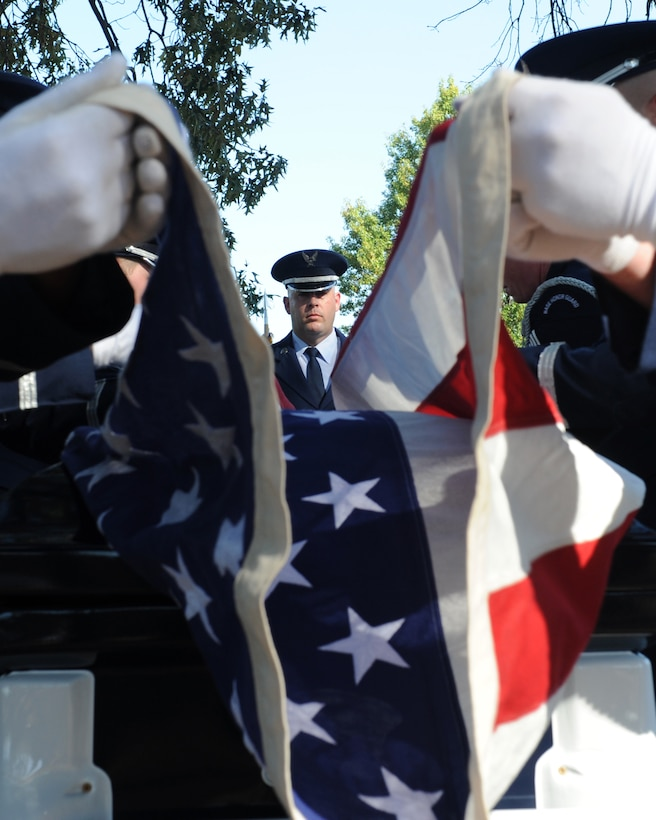 U.S. Air Force Master Sgt. Jason Crumpton, Little Rock Air Force base Honor Guard superintendent, supervises the folding of a flag Oct. 6, 2016, at Little Rock Air Force Base, Ark. Base Honor Guard members travel throughout Arkansas and as far as Memphis, Tennessee, to honor fallen service members. (U.S. Air Force photo by Airman Grace Nichols)