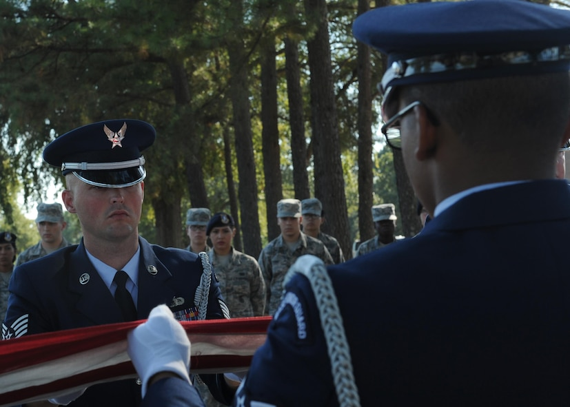 U.S. Air Force Staff Sgt. James Gentry, Team Little Rock Honor Guard Ceremonial Guardsman, assists with a seven-man flag fold Oct. 6, 2016, at Little Rock Air Force Base, Ark. Honor Guard members are trained in a variety of military ceremonial services. (U.S. Air Force photo by Airman Grace Nichols)