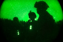 As seen through a night-vision device, Marines participate in a helicopter support team training exercise on Phoenix landing zone at Camp Lejeune, N.C., Oct. 20, 2016. Marine Corps photo by Lance Cpl. Jack A. E. Rigsby