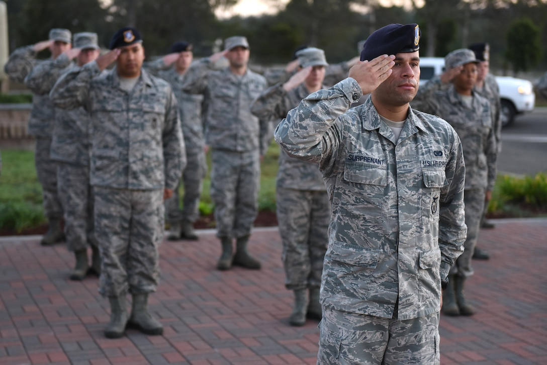 Members of Airman Leadership School Class 17-Alpha salute during Reveille, Oct. 25, 2016, Vandenberg Air Force Base, Calif. During their time in ALS, students embark on a 192-hour, 24-day journey designed to develop leadership abilities, the profession of arms, and effective communication. (U.S. Air Force photo by Airman 1st Class Robert J. Volio/Released)