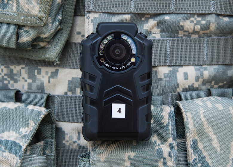 A single body worn camera rests on an 11th Security Forces Squadron officer's flak vest at Joint Base Andrews, Md., Oct. 4, 2016. These devices were implemented Oct. 26 as part of an Air Force-level test to determine which kind of camera will best suit the service's defenders and their procedures. (U.S. Air Force photo by Senior Airman Jordyn Fetter)