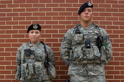 Airman 1st Class Sarah Shepherd, left, and Staff Sgt. Sawyer Fox, right, 11th Security Forces Squadron response force leaders, display the wear of body cameras at Joint Base Andrews, Md., Oct. 4, 2016. JBA defenders began donning the body worn cameras Oct. 26 as part of a six-month-long Air Force-level test to determine which product to use. The cameras will be evaluated on their video quality, usefulness, and how they can be better utilized. (U.S. Air Force photo by Senior Airman Jordyn Fetter)