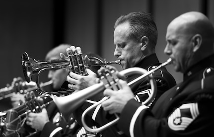U.S. Air Force Band's Airmen of Note trumpeters, Senior Master Sgt. Kevin Burns and Chief Master Sgt. Tim Leahey, perform during the during a 2016 Jazz Heritage Series performance at the Rachel M. Schlesinger Concert Hall in Alexandria, Va., Oct. 21, 2016. The Airmen of Note established the Jazz Heritage Series in 1990 and each year they perform with legendary icons of jazz. (U.S. Air Force photo by Airman Gabrielle Spalding)