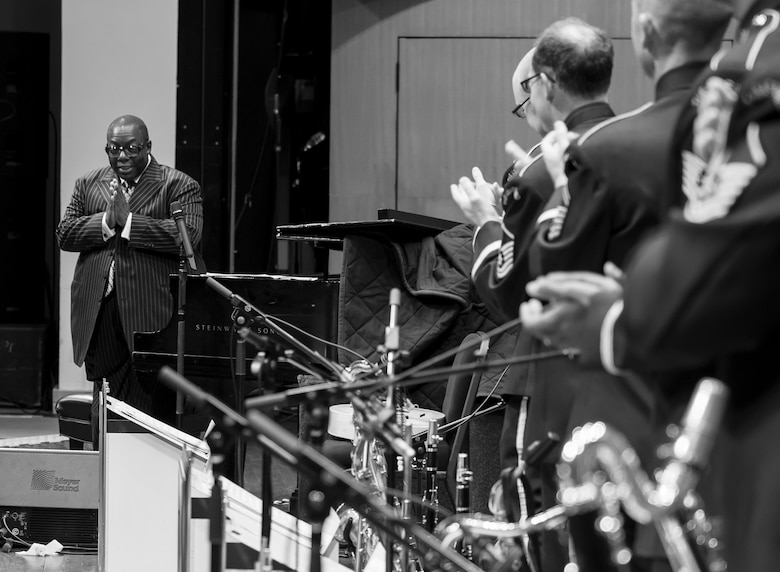 Members of the U.S. Air Force Band's Airmen of Note applaud Cyrus Chestnut, jazz pianist, during a 2016 Jazz Heritage Series performance at the Rachel M. Schlesinger Concert Hall in Alexandria, Va., Oct. 21, 2016. Chestnut, who has worked with many big bands, including the Lincoln Center Jazz Orchestra and the Dizzy Gillespie All-Star Big Band, was the featured guest during this series performance. The Airmen of Note established the Jazz Heritage Series in 1990 and each year they perform with legendary icons of jazz. (U.S. Air Force photo by Airman Gabrielle Spalding)