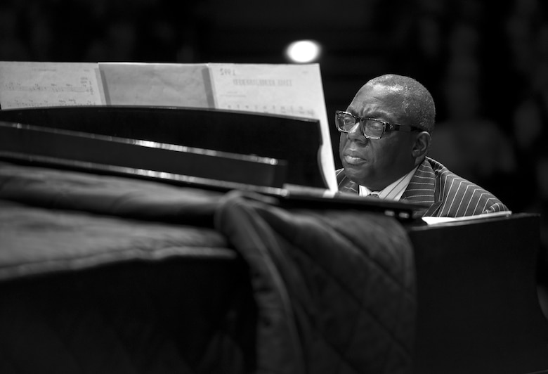 Cyrus Chestnut, jazz pianist, plays the piano during a 2016 Jazz Heritage Series performance at the Rachel M. Schlesinger Concert Hall in Alexandria, Va., Oct. 21, 2016. Chestnut, who has worked with many big bands, including the Lincoln Center Jazz Orchestra and the Dizzy Gillespie All-Star Big Band, was the featured guest during this series performance. The Airmen of Note established the Jazz Heritage Series in 1990 and each year they perform with legendary icons of jazz. (U.S. Air Force photo by Airman Gabrielle Spalding)